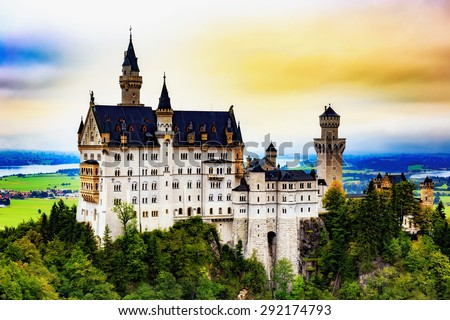 Neuschwanstein Castle, Lovely Autumn Landscape Panorama Picture of the fairy tale castle near Munich in Bavaria, Germany. Sunrise on a cloudy september day - stock photo