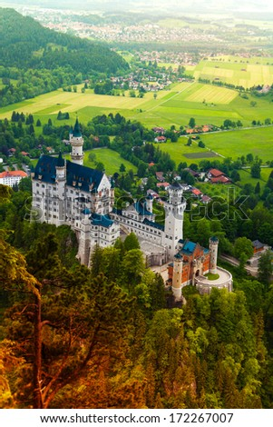 Neuschwanstein view from above over the waterfall with surround villages - stock photo