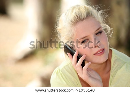 Neutral woman talking on her mobile phone - stock photo