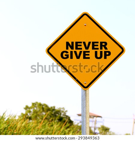 Never Give Up on traffic sign - stock photo