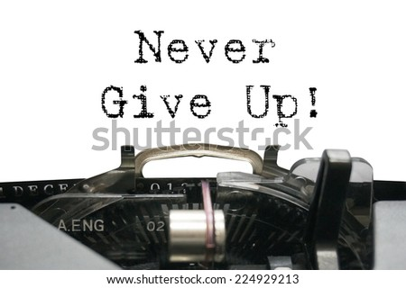 Never give up on typewriter - stock photo