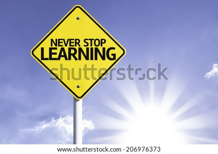 Never Stop Learning road sign with sun background  - stock photo