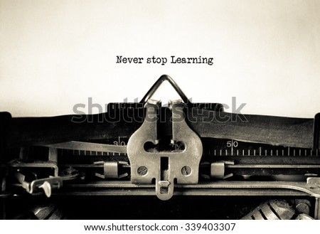 Never Stop Learning word typed on a Vintage Typewriter.  - stock photo