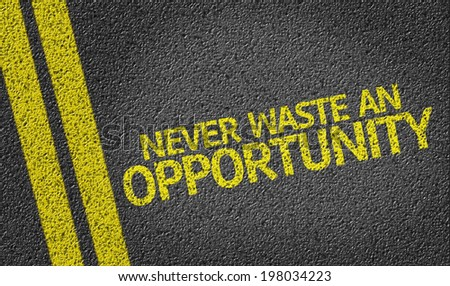 Never Waste An Opportunity! written on the road - stock photo