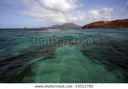 Nevis and St. Kitts, as seen from a dock on Nevis in the West Indies. - stock photo