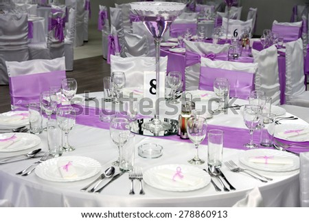 new and clean luxury empty restaurant with glasses set for dinner wedding day - stock photo