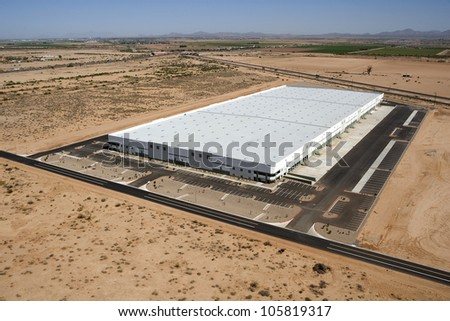 New and modern aerial view of a very large distribution warehouse - stock photo
