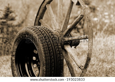 new and old broken wagon (car) wheel - stock photo