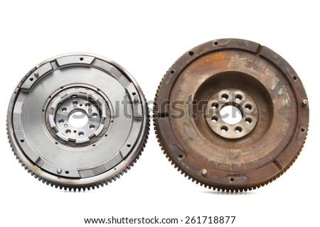 new and old rusty damping flywheels for automotive diesel engines on a white background. car parts - stock photo