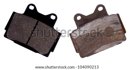 New and worn brake pad, isolated on background - stock photo