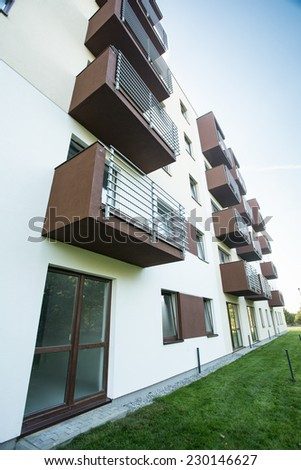 New apartment building having brown painted balconies - stock photo