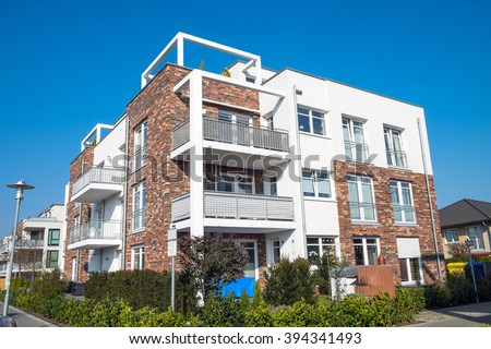 New apartment building with balconies seen in Germany - stock photo