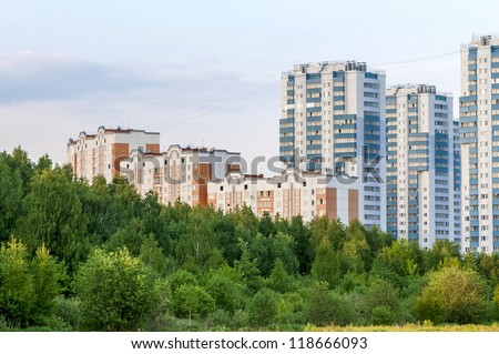 new apartment buildings in eco-friendly green belt (evening time) - stock photo