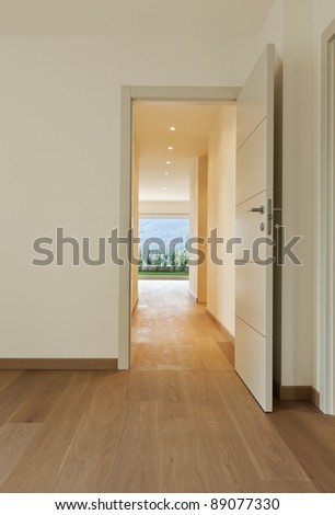 new apartment, empty corridor, open doors - stock photo