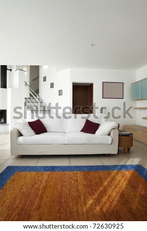 new apartment, white sofa in large living room - stock photo