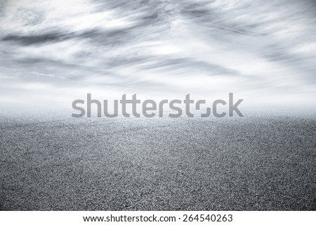 new asphalt road and sky - stock photo