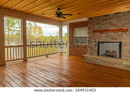 New backyard deck with fireplace overlooking lake - stock photo