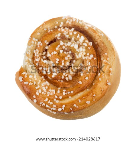 New baked cinnamon bun with pearl sugar on top photographed from above - stock photo