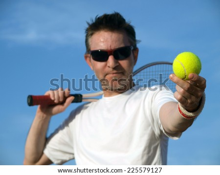 New balls,focus on tennis ball - stock photo
