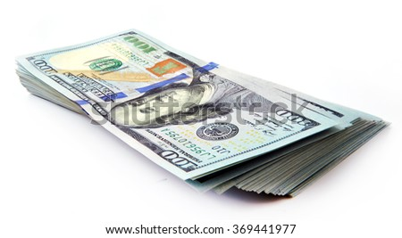 New banknotes of dollars on a white background - stock photo