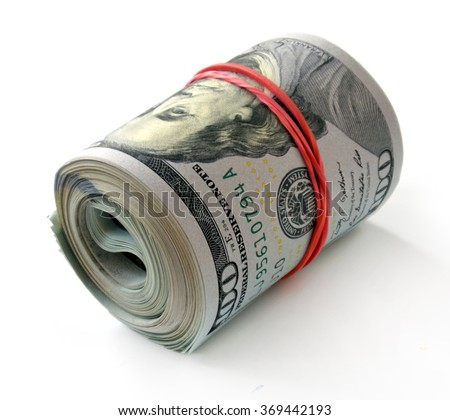 New banknotes of dollars roll on a white background - stock photo