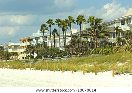 New beautiful and typical american town houses on beach in florida - stock photo