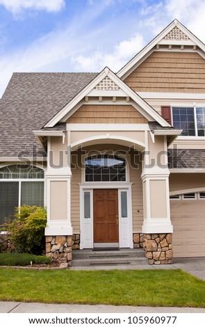 new beautiful suburban luxury house at sunny day - stock photo