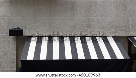 new black and white awning on concrete wall, free copy space    - stock photo