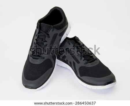 New black sports shoes on white background - stock photo