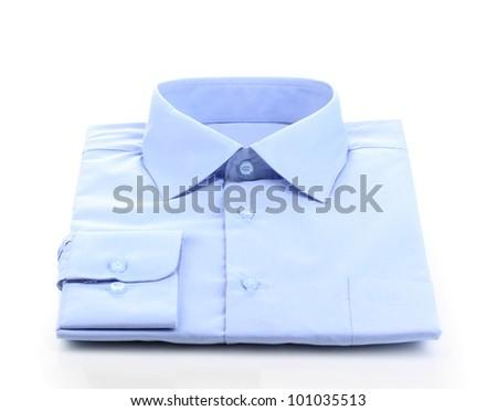 New blue man's shirt isolated on white - stock photo