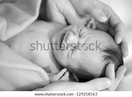 New born baby crying - stock photo
