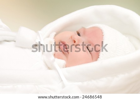 New born baby girl dressed in white. - stock photo