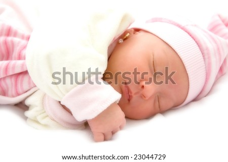 New born baby girl peacefully sleeping. - stock photo