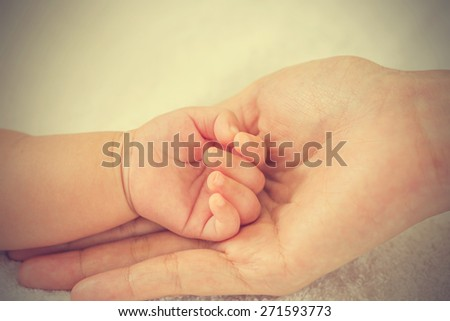 New born baby hand - vintage effect style pictures - stock photo