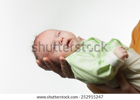 New born baby in father hands on white - stock photo