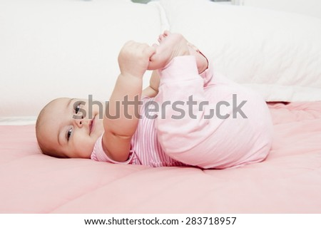 New born baby in the bed . - stock photo