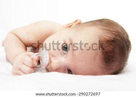 New born baby on the bed - stock photo