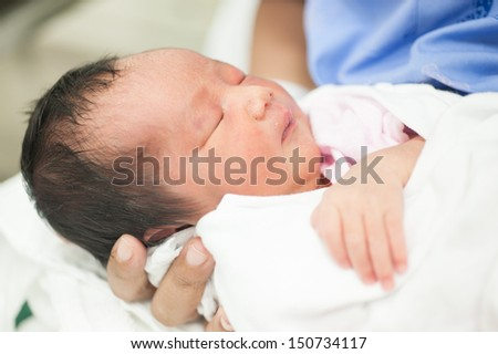 new born baby portrait in hospital - stock photo