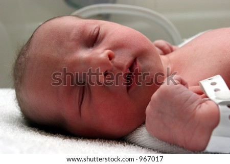 New born baby resting - stock photo