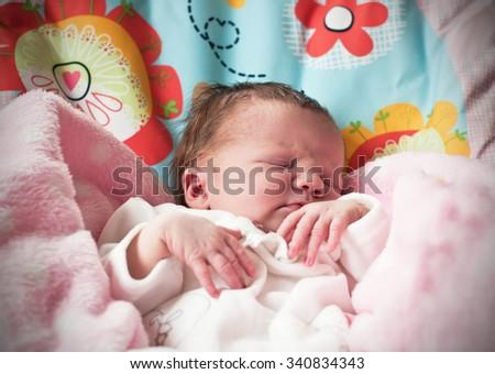 New born baby sleeping - stock photo
