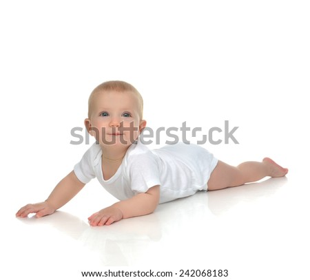 New born 8 month infant child baby boy lying happy smiling on a white background - stock photo
