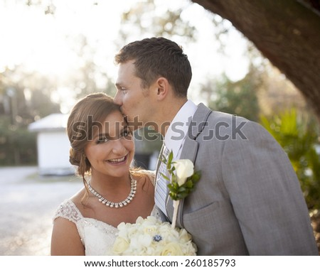 New bride and groom having a fun moment together - stock photo