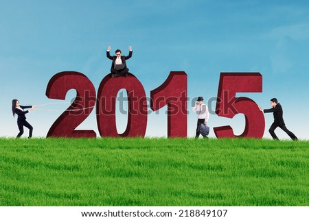 New business arrangement concept with bussiness people arrange number 2015 - stock photo