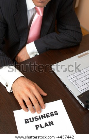 new business concept with a Business Plan and businessman - stock photo