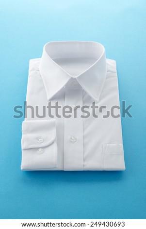 new business shirt on blue background - stock photo