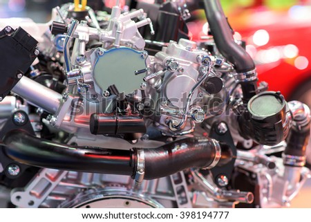New car engine, selective focus at silver tube - stock photo