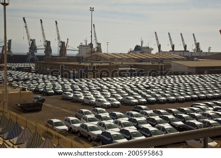 New cars lined up in the port - stock photo