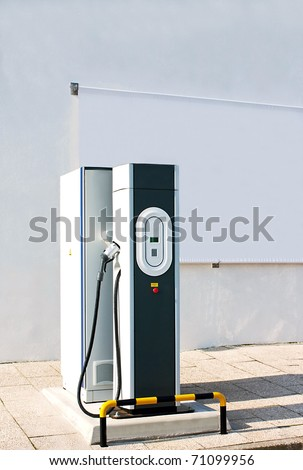 New charging station for electric car with a white canvas panel for outdoor advertising - stock photo