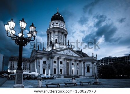 New Church (Deutscher Dom or German Cathedral) on Gendarmenmarkt in the evening - stock photo