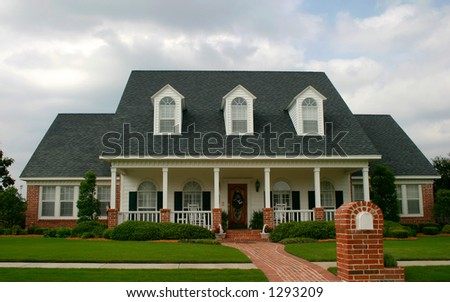 new classic design house in suburban neighborhood; new old house - stock photo